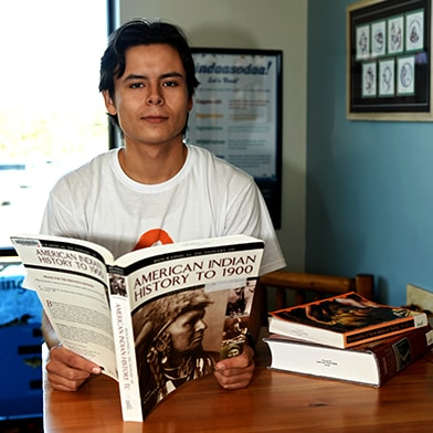 LLTC student studying History book