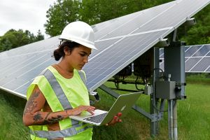 IRB student entering data at the solar panels
